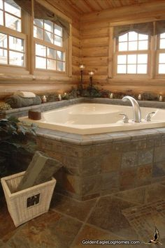 A whirlpool tub surrounded by beautiful heated tile. Even if you live in extreme north, your bathroom can have the feel of a resort spa. A warm room with candles, soap suds, and a great book make all your daily issues go away.    Pictured above is a whirlpool tub. Golden Eagle Log Homes has a number of tub options that come standard with our packages. Guaranteed to fix properly in your new log home. - logcabinhomes