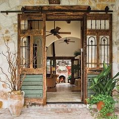 warm wood stone ceiling fans distressed spanish entry way