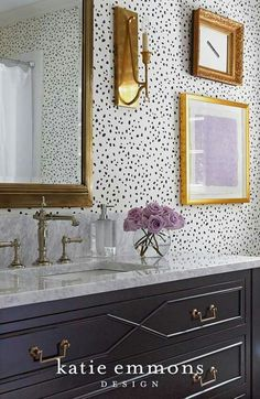 Such a lovely choice of wallpaper. The polka dots are light and playful and the black & white looks great with the gold frames.