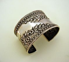 Extra Wide Cuff Bracelet With Repousse Work of Flowers And Vines.