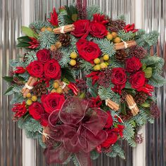 How about this for a bit of luxury on your front door? https://www.flowerstudioshop.co.uk/shop/christmas-luxury-fresh-red-rose-wreath/
