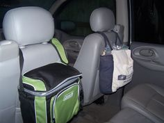 I used a hard sided cooler to hold all my kids electronic gadgets, and a soft sided bag to hold all our trip snacks during our recent 18 hour drive to Disney World. Worked great to maximize space in the back seat of the Trailblazer and kept it neat and tidy and organized.-- how smart. Not just for kids, it's a great idea for making space when traveling for anyone!