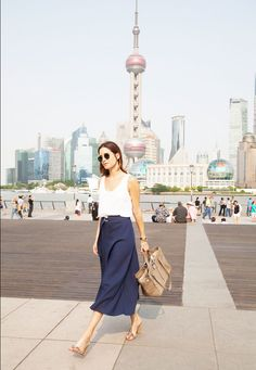 Flowy midi skirts and crop tops are an easy and chic solution to the summer heat