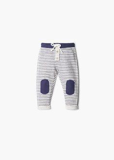 Pantalon à rayures et genouillères