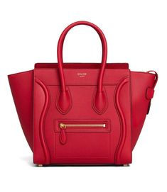Phoebe Philo collection. The Celine Luggage in micro size shows off the brand's impressive craftsmanship and attention to detail with red drummed leather accented by tonal stitching that's both subtle and sophisticated. Beloved and carried by fashion editors and fashionistas alike, the Luggage has cemented its status as a must-have modern classic. Made in Italy. Will ship with dust bag. CONDITION Light marks to metal feet Exterior - Drummed calfskin leather body - Goldtone hardware - Double…