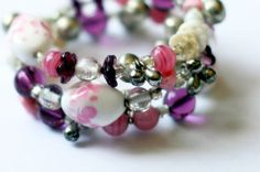 Vintage & Mixed Beads Pink And Purple Memory Wire Bracelet With Bells from Fancy Dodo