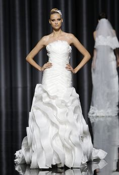Pronovias - Fall 2012. Strapless pleated organza mermaid wedding dress with a ruffle skirt, Pronovias