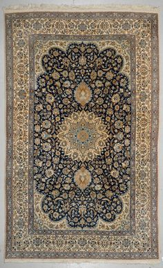NAIN.  Dark-blue central field with a central medallion. The entire carpet is…