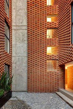 Bricks as texture, against concrete panels.  Mexico