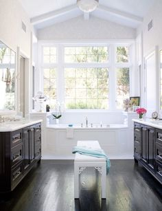 Hollly bajeebers...this is my dream bathroom layout...his/hers sinks and a bathtub surrounded by windows. Just beautiful..and love the touch of the white asian zen bench