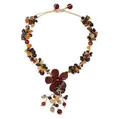 "NOVICA Jasper, Dyed Quartz, Garnet, and Carnelian Flower Necklace, 15.25"", 'Dazzling Bloom'. An original NOVICA fair trade product in association with National Geographic. Includes an official NOVICA Story Card certifying quality & authenticity. NOVICA works with Nareerat to craft this item. Includes an original NOVICA jewelry pouch to keep for yourself or give as a gift. A keepsake treasure designed to be loved for years to come."