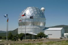 The Hobby–Eberly Telescope (HET) is a 9.2-meter (30-foot) aperture telescope located at the McDonald Observatory. It is one of the largest optical telescopes in the world and combines a number of features that differentiate it from most telescope designs, resulting in greatly lowered construction costs. For instance, the primary mirror is constructed from 91 hexagonal segments, which is less expensive than manufacturing a single large primary.