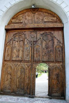 The Heaven's doors by tomcezar  -- The doors of Cocos Monastery, made from masive wood and sculpted by hand. In Tulcea county at 6 km from Niculitel village.