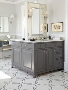 Stunning contemporary master bathroom design with soft gray walls and custom charcoal gray bathroom cabinets with antique mirror doors, and matching gray double floating vanity with marble countertop and his and her sinks. Grey Bathroom Cabinets, Grey Bathroom Vanity, Gray Vanity, Grey Bathrooms, Beautiful Bathrooms, Gray Cabinets, Bathroom Vanities, Luxury Bathrooms, Bathroom Island