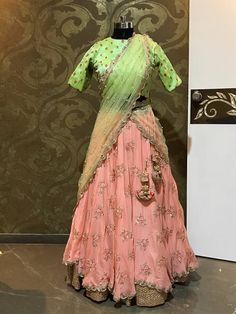 Beautiful blush pink color lehenga and green color high neck designer blouse with green net duppata. Both lehenga and blouse with hand embroidery buti work from Vasthra creations. 16 July 2017