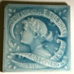 """*BLUE TILE:   from the late 19th Century.  It was made to celebrate the opening of a new factory in Zanesville, Ohio, by: the American Encaustic Tiling Company. It illustrates a classical theme alon gw/ the inscription """"Dedication: A.E. TILE WORKS ZANESVILLE OF APRIL 19, 1892"""".  The back is signed w/ marks in raised letters. As fine as a cameo Tile Art, Mosaic Art, Mosaic Tiles, Mosaics, Antique Tiles, Vintage Tile, Zanesville Ohio, Cross Country Trip, Brown County"""