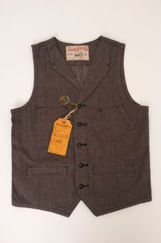 "Sugar Cane Lapel Vest this one will get you far, goes with anythign makes you look like a stylish man even with jeans ""  get it"