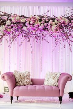 This spring inspired stage blossoms beautifully with branches and flowers, overheading a super cute sofa with fur pillows <3 | Curated by Witty Vows – Things No one tells brides |The ultimate guide for the Indian Bride to plan her dream Indian wedding. Real weddings, ideas, trends, recomendations and inspiration | ♥ ♥ ♥ | Photo - xaazablog.com | #reception #engagement #stage #backdrop #inspiration #IndianWedding | www.wittyvows.com