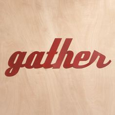 """""""GATHER"""" SIGN--A direct order of the most pleasant sort, handcrafted by an Amish craftsman known around Lancaster County as Rusty Merv. Merv himself cuts the sheet steel, then applies a rust-red weatherproof paint finish for the patina of a vintage flea-market collectible. 58""""W x 20-1/2""""H."""