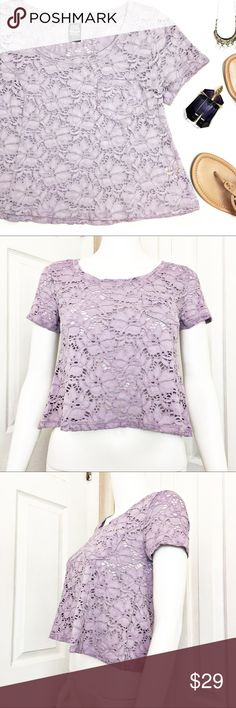 """Free People Floral Lace Crop Tee This Free People crop tee is adorable and perfect for summer.  Lilac in color with An all over lacy eyelet style.  Pair this with a Bralette and your favorite jean cut offs.  Material tag has been listed. Measurements laid flat: Bust: 16"""" Length from top of shoulder to hem: 18"""" *Measurements are approximate. Free People Tops Tees - Short Sleeve"""