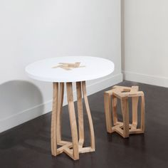 a table and stool whose entire structure relies on five identical elements - which are up-side-down 'U' shapes - fitting into one another.