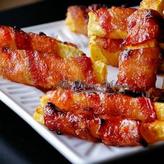 Grilled Sriracha Candied Bacon Wrapped Pineapple -- ooh my...I have some family members who would go CRAZY over these!