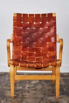 """Woven chairs used by Mathsson in place of traditional spring upholstery were innovative for the time. The design of the 'Eva Chair' (above) was originally commissioned to Mathsson by a hospital in Sweden. His innovative design was unorthodox for 1930 and hospital staff found the chairs so ugly that they referred to them as """"Grasshoppers."""" They went into storage and traditional furniture used. If you're wondering on the value of his designs today- see above for the price of 2 """"grasshoppers""""."""