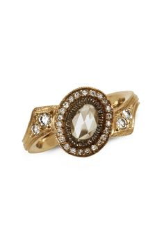 Just Jules' split bar pin ring in 14k gold with with 0.3 ct. oval-shape rose-cut diamond and 0.28 ct. t.w. pavé; $2,860