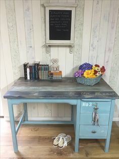 Coastal-themed Vintage desk, painted in an ASCP custom-mix aqua, faux plank, stencilled top, and fish drawer pulls. The piece is sealed and aged with ASCP white and dark waxes.