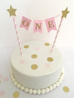 This listing is for an adorable first birthday cake bunting. This is done with pink high quality paper straws with glitter gold star embellishments. This is great for a smash cake!! This item can be customized to your color theme! Just convo me and I would be glad to create a custom order for you!! ***IMPORTANT: PLEASE INCLUDE THE DATE OF YOUR EVENT IN THE NOTES SECTION WHEN ORDERING*** Your item will be carefully packaged and shipped to you via USPS First Class Mail. Once a package is sh...