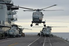 Navy's new helicopter has paid its first visit to HMS Illustrious