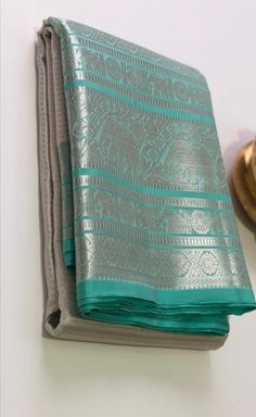Aesthetically captivating Kanchipuram pure silk saree for our fashion connoisseur. WhatsApp us on 8104099526 for more details/purchase. Kanjivaram Sarees Silk, Indian Silk Sarees, Pure Silk Sarees, Gold Silk Saree, Wedding Silk Saree, Half Saree Designs, Silk Saree Blouse Designs, Saree Designs Party Wear, South Silk Sarees