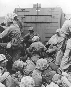 Marines crouched in a Coast Guard-manned LCVP on the way in on the first wave to hit the beach at Iwo Jima, 19 Feb 1945.