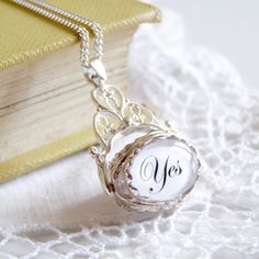 """The Decision Maker heirloom NECKLACE...""""Simply ask your question, spin the disk and wait for it to settle on Yes or No or Maybe."""""""