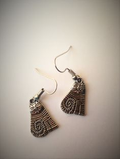 This unique pair of cat earrings is the purrfect gift for cat lovers or keep them for yourself to show your love of your four legged, furry friends.