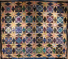 """Morning After The Storm"" , a storm at sea quilt, by Tina Rathbone.  Elaborate quilting with trapunto."