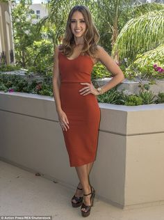 Flaunting her figure: Jessica Alba stunned in a form-fitting, sleeveless dress as she attended a photocall for Mechanic: Resurrection on Friday in Los Angeles