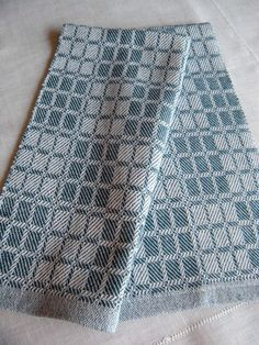 Handwoven towel designed with Swedish Drall twill blue and white blocks in 100 percent cotlin. Cotlin yarn has been spun with 60 percent linen