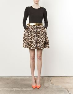 fun outfit: animal print full skirt, gold belt  orange heels. Don't know if I could pull this off, but love!