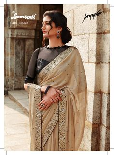 Carry this trendy creation! It will surely fetch out everyone's attention. The lots of diamonds are studded on burly wood georgette saree as well as in black unstiched blouse. A vibrant look to your personality. Indian Suits, Indian Attire, Indian Wear, Laxmipati Sarees, Georgette Sarees, Indian Designer Sarees, Pakistani Designers, Latest Indian Saree, Indian Sarees