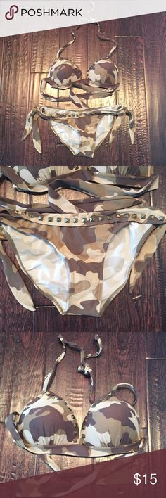 Camo swimsuit Lightly used. Excellent condition! Cute camo print with fierce metal studs. Top is size D bottoms size 10. Adjustable ties all around to fit various sized, beautiful bodies. VENUS Swim Bikinis