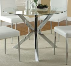 """Features: -Material: Metal and glass. -Finish: Chrome. -Style: Mid-century modern. -Shape: Round. -Double pedestal. -Tempered glass table top. Dimensions: Overall Height - Top to Bottom: -30""""."""
