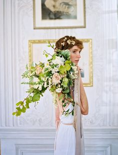 Lush green and pale pink overgrown wedding bouquet