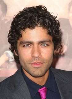 10 Famous Men with Curly Hair: Adrian Grenier