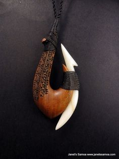 Janet's - Pacific Wood Pendant BRPWD01, 124.00 AUD (http://www.janetssamoa.com/pacific-wood-pendant-brpwd01/) Pacific Fishing Hook Made from Composite Samoan Wood (Ifilele) and Cattle Bone. Samoan Tatau/Tattoo Designs Carved and Inked onto Wood. Polynesian Afa (Coconut Husk) Adjustable string length for comfortable fit