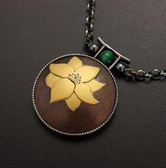 Flower motif gold Keum Boo on Kuroshibuichi necklace by KAZNESQ on Etsy https://www.etsy.com/listing/173021636/flower-motif-gold-keum-boo-on