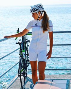 4720bd404 Women on bikes. — All white cycling outfit by the sea