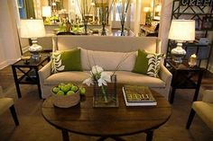 what a nice small couch and the olive green and cream color with the wood coffee table makes it feel so earthy and welcoming.