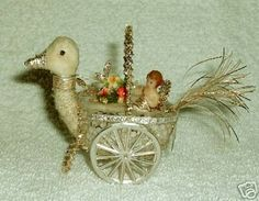 Sebnitz Swan Cart with wax baby. By Betsy Browning.. browning.designwerks