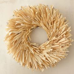 """A simple adornment for the doorstep, this monochromatic wreath is made from natural, dried corn husks.- Corn husks, twig base- Avoid direct sunlight, humidity or moisture- Indoor use recommended for best longevity- Imported5""""D, 22"""" diameter"""